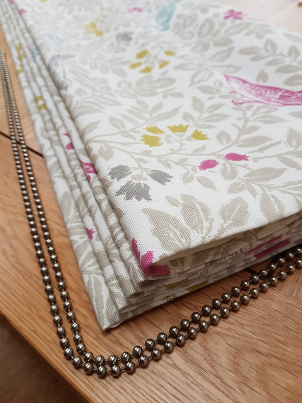 Roman Blind by Lucy J Interiors.  Terry's Fabric